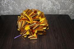 Большой упаковочный бант золотистого цвета