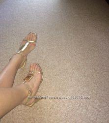 Босоножки женские кожаные на устойчивом каблуке Carlo Pazolini, золотистые