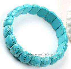 Эластичный браслет из бирюзы  размер бусины 11х15 мм .