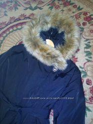 Красивое качественное пальто пуховик с енотовым мехом