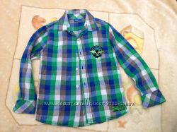 Продам яркую клетчатую рубашку 140 размера