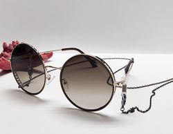 Стильні окуляри кргулі в комплекті із ланцюжком