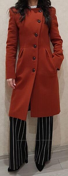Продам женское демисезонное пальто.