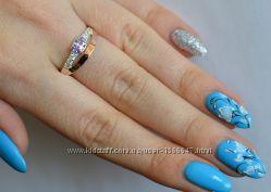 Серебряное кольцо с камнем и золотыми пластинами 375 проба