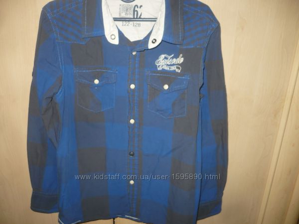 Рубашка т. синяя на мальчика 122-128р.