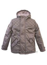 Продам новую зимнюю куртку Frantolino 134 см