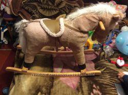 Конь каталка